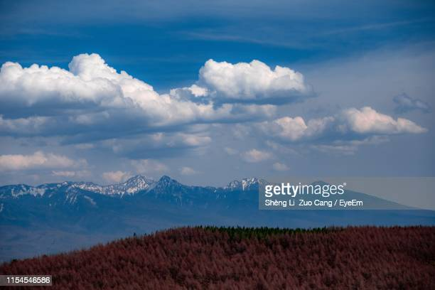 scenic view of snowcapped mountains against sky - 長野市 ストックフォトと画像