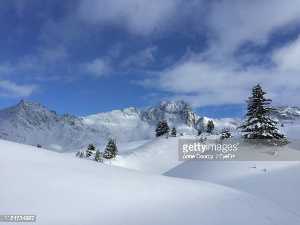 scenic view of snowcapped mountains against sky - la plagne stock photos and pictures