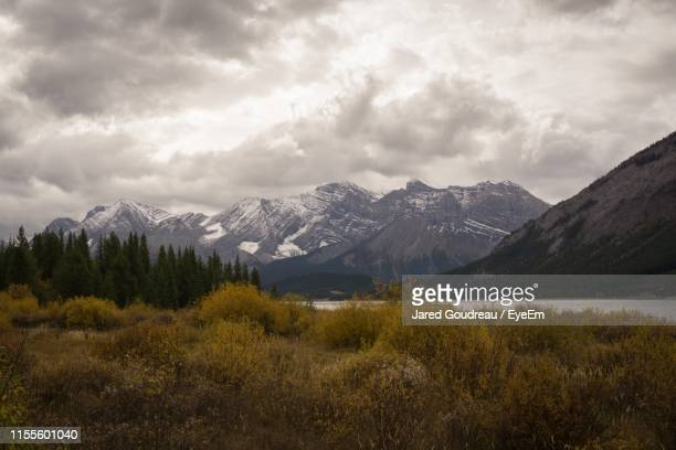 scenic view of snowcapped mountains against sky - kananaskis country stock pictures, royalty-free photos & images