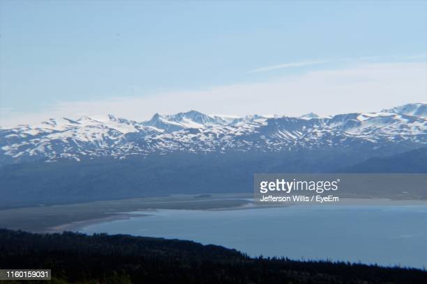 scenic view of snowcapped mountains against sky - home run ストックフォトと画像