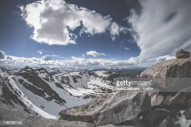 scenic view of snowcapped mountains against sky - duchene stock photos and pictures