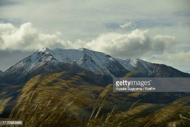 scenic view of snowcapped mountains against sky - invercargill stock pictures, royalty-free photos & images