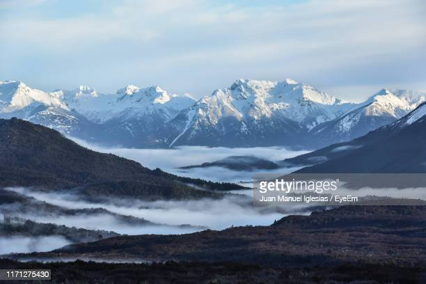 scenic view of snowcapped mountains against sky - リオネグロ州 ストックフォトと画像