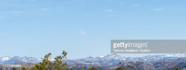 scenic view of snowcapped mountains against sky - egersund stock photos and pictures