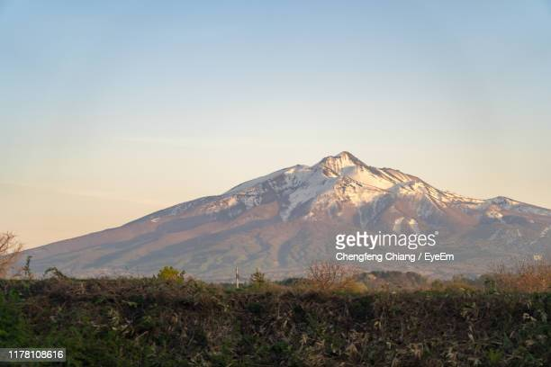 scenic view of snowcapped mountains against sky - aomori prefecture stock pictures, royalty-free photos & images