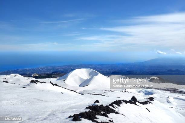 scenic view of snowcapped mountains against sky - etna foto e immagini stock
