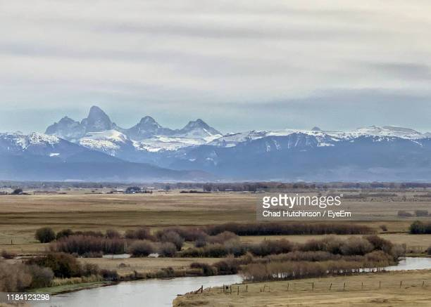 scenic view of snowcapped mountains against sky - idaho falls stock pictures, royalty-free photos & images