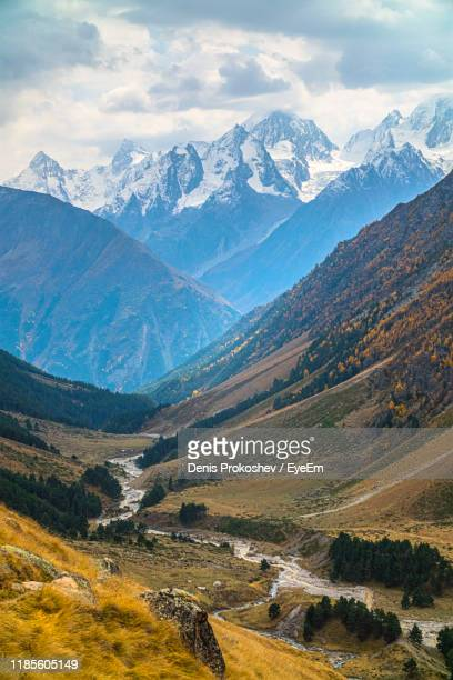 scenic view of snowcapped mountains against sky - 北コーカサス ストックフォトと画像