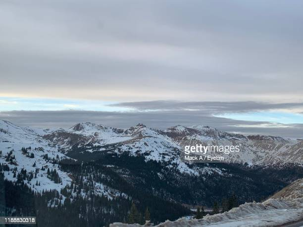 scenic view of snowcapped mountains against sky - mack stock pictures, royalty-free photos & images