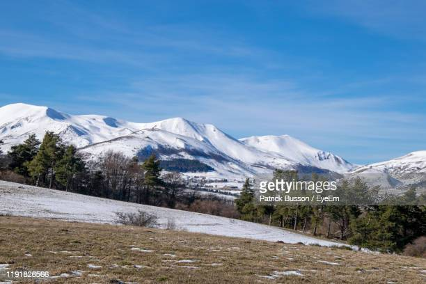 scenic view of snowcapped mountains against sky - auvergne rhône alpes stock pictures, royalty-free photos & images