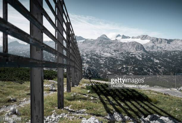 scenic view of snowcapped mountains against sky - christian soldatke stock-fotos und bilder