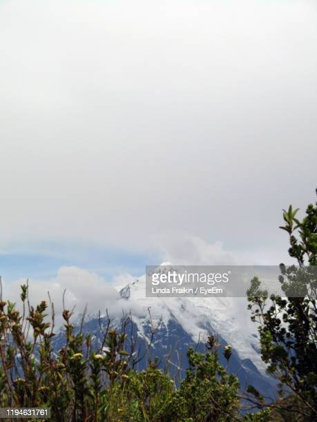 scenic view of snowcapped mountains against sky - linda fraikin stock pictures, royalty-free photos & images