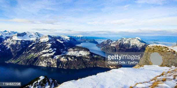 scenic view of snowcapped mountains against sky - schwyz stock pictures, royalty-free photos & images