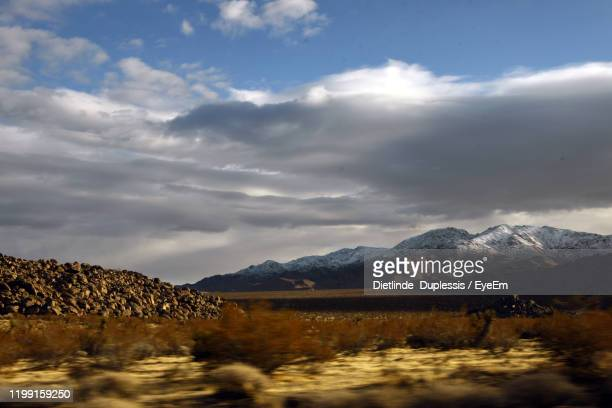 scenic view of snowcapped mountains against sky - dietlinde duplessis stock pictures, royalty-free photos & images
