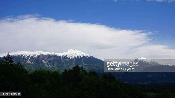scenic view of snowcapped mountains against sky - sahne ストックフォトと画像