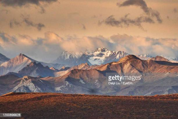 scenic view of snowcapped mountains against sky - wilderness stock pictures, royalty-free photos & images