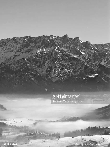 scenic view of snowcapped mountains against sky - leogang stock pictures, royalty-free photos & images