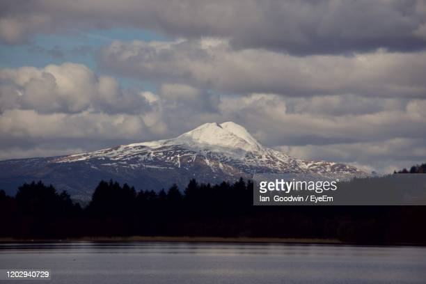 scenic view of snowcapped mountains against sky - april fools day stock pictures, royalty-free photos & images