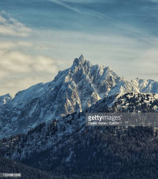 scenic view of snowcapped mountains against sky - ムジェーヴ ストックフォトと画像