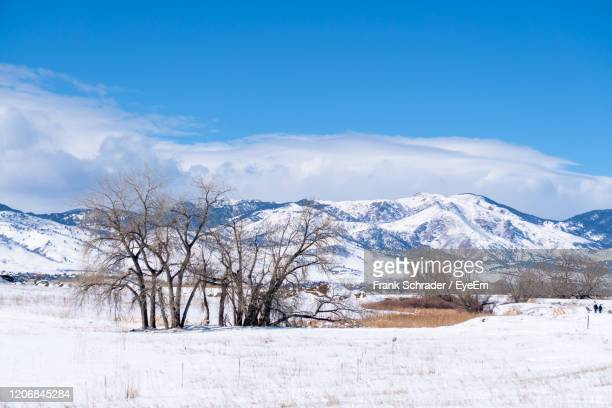 scenic view of snowcapped mountains against sky - frank schrader stock pictures, royalty-free photos & images