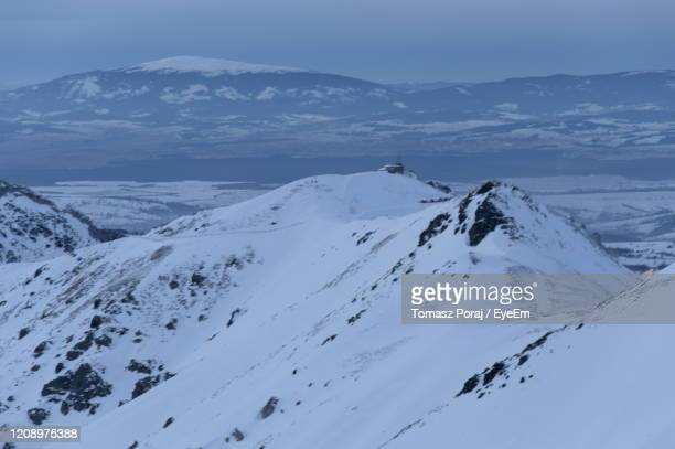 scenic view of snowcapped mountains against sky - babia góra mountain stock pictures, royalty-free photos & images