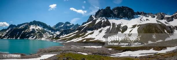 scenic view of snowcapped mountains against sky - michael jaeger stock pictures, royalty-free photos & images