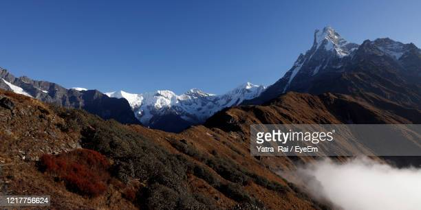 scenic view of snowcapped mountains against sky - annapurna south stock pictures, royalty-free photos & images
