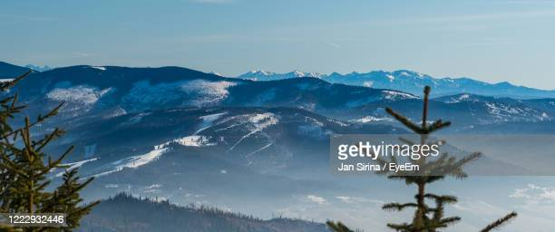 scenic view of snowcapped mountains against sky - cieszyn stock pictures, royalty-free photos & images