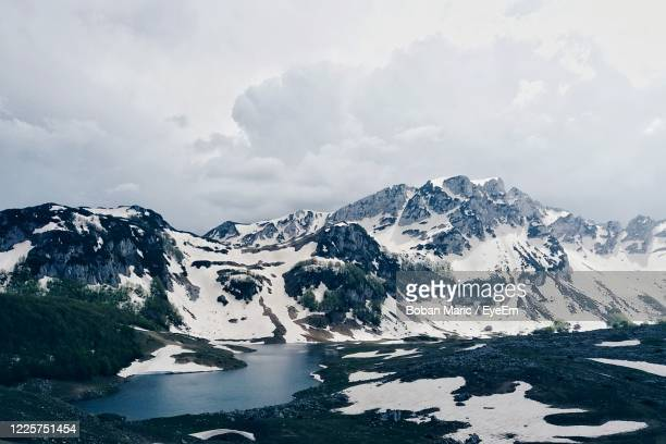 scenic view of snowcapped mountains against sky - boban stock pictures, royalty-free photos & images