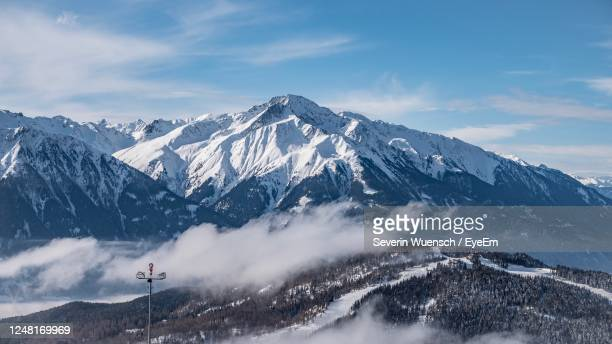 scenic view of snowcapped mountains against sky - ゼーフェルト ストックフォトと画像