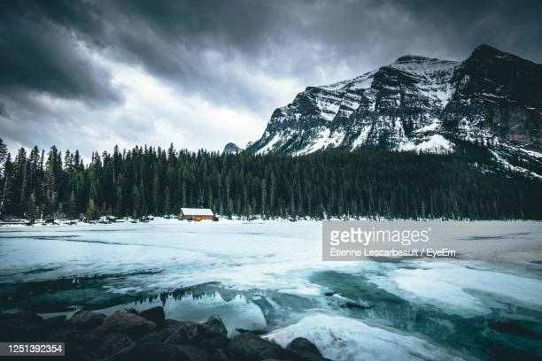 scenic view of snowcapped mountains against sky - lake stock pictures, royalty-free photos & images