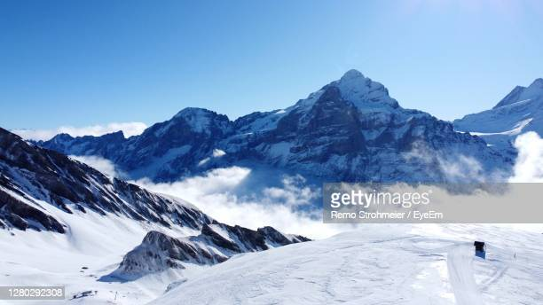 scenic view of snowcapped mountains against sky - snowcapped mountain stock pictures, royalty-free photos & images