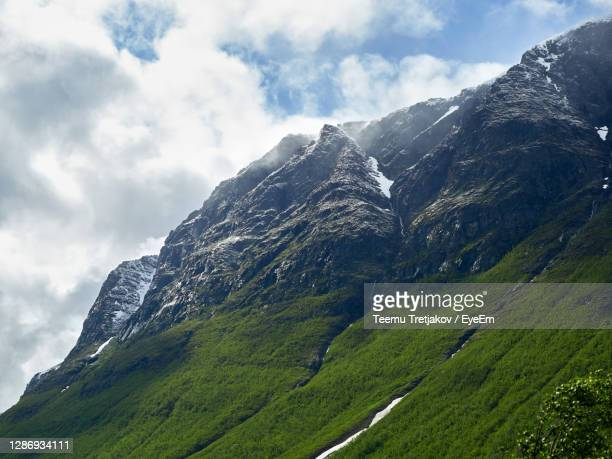 scenic view of snowcapped mountains against sky - teemu tretjakov stock pictures, royalty-free photos & images
