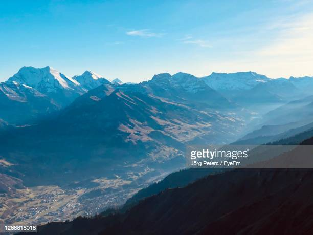 "scenic view of snowcapped mountains against sky - ""jörg peters"" stock-fotos und bilder"