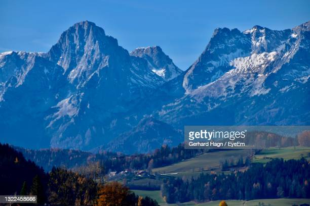 scenic view of snowcapped mountains against sky - gerhard hagn stock-fotos und bilder