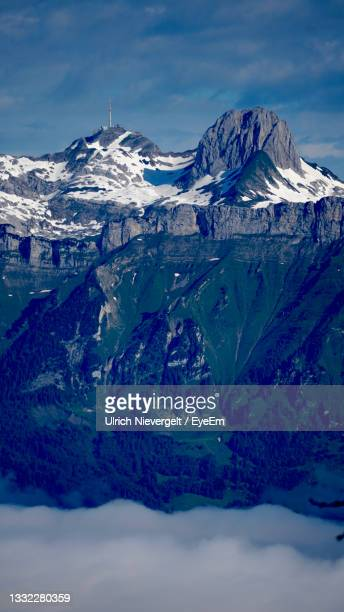 scenic view of snowcapped mountains against sky - vaduz stock pictures, royalty-free photos & images