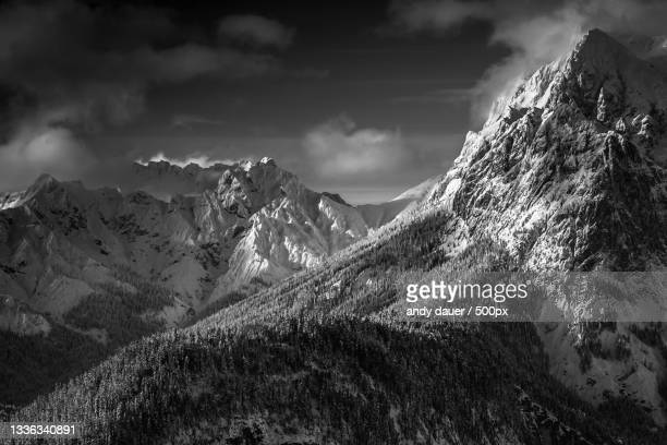 scenic view of snowcapped mountains against sky - andy dauer stock pictures, royalty-free photos & images