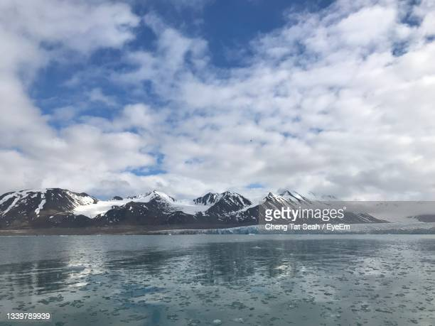 scenic view of snowcapped mountains against sky - svalbard and jan mayen stock pictures, royalty-free photos & images