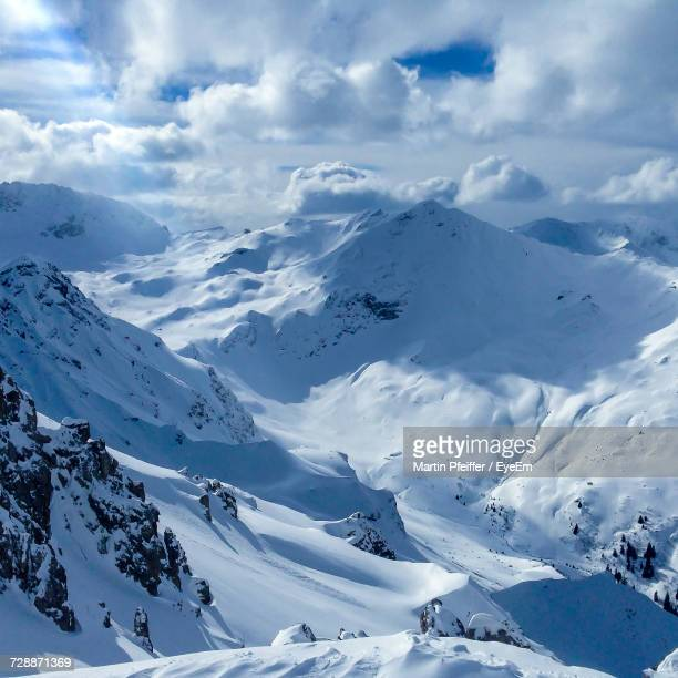 scenic view of snowcapped mountains against sky - アロサ ストックフォトと画像