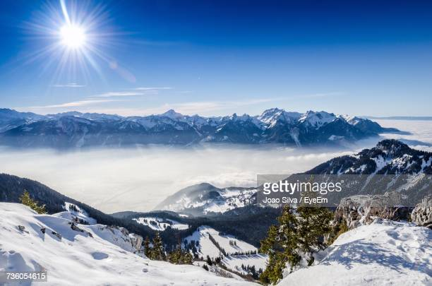 scenic view of snowcapped mountains against sky - leysin stock photos and pictures