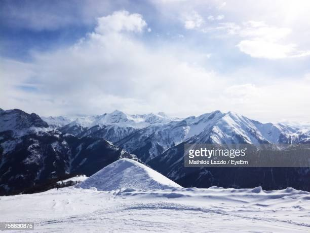 scenic view of snowcapped mountains against sky - chaîne de montagnes photos et images de collection
