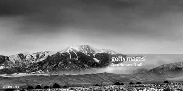 scenic view of snowcapped mountains against sky - san juan mountains stock photos and pictures