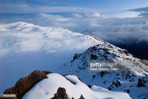 scenic view of snowcapped mountains against sky - marek stefunko stockfoto's en -beelden