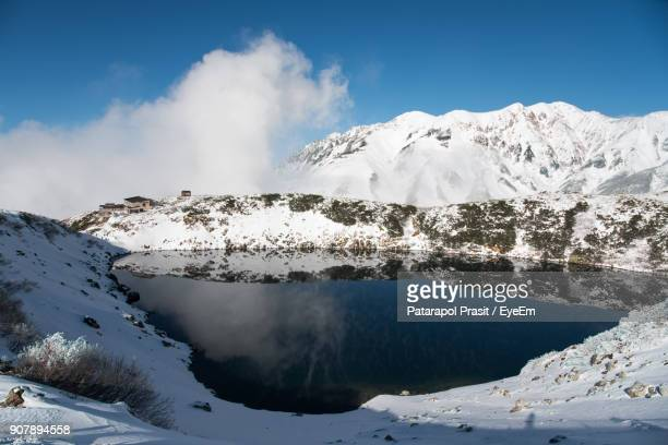 scenic view of snowcapped mountains against sky - 富山県 ストックフォトと画像