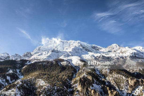 scenic view of snowcapped mountains against sky - didier marti stock photos and pictures