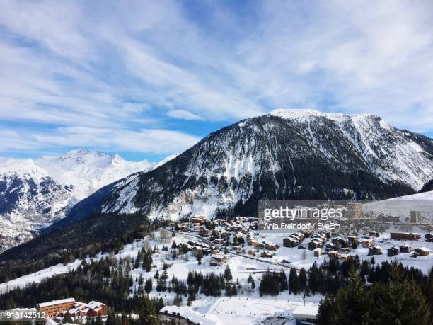 scenic view of snowcapped mountains against sky - trois vallees stock pictures, royalty-free photos & images