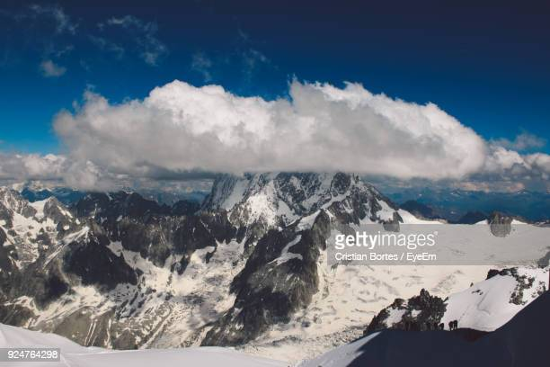 scenic view of snowcapped mountains against sky - bortes stockfoto's en -beelden