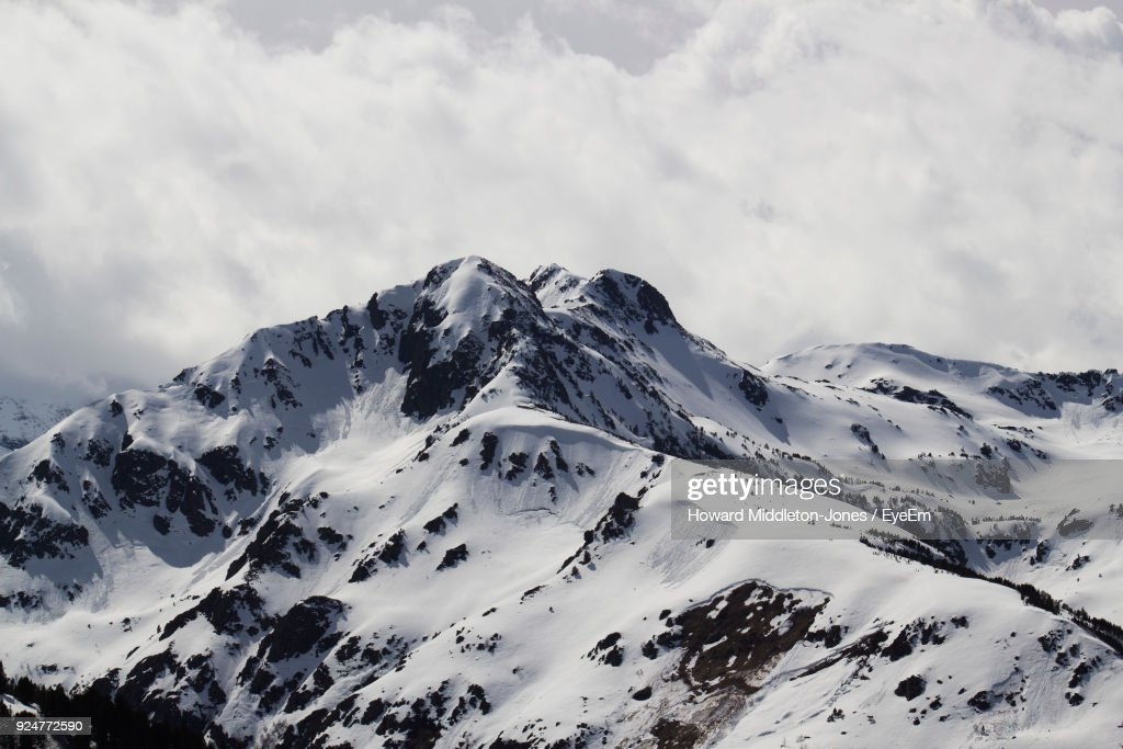 Scenic View Of Snowcapped Mountains Against Sky : ストックフォト