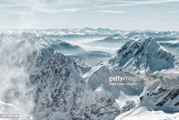 scenic view of snowcapped mountains against sky - kälte stock-fotos und bilder