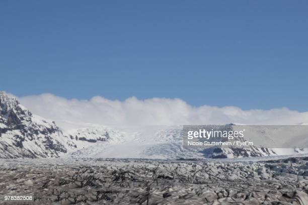 scenic view of snowcapped mountains against sky - stutterheim stock photos and pictures